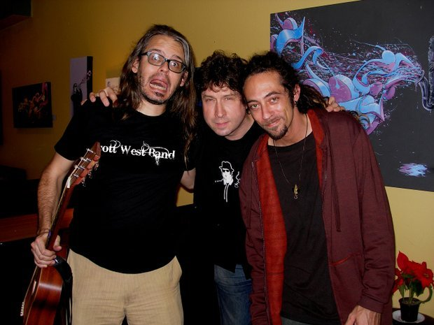 (Left to right: guitarist Wil Forbis, Scott West, and Justin Werner wearing the red shirt)