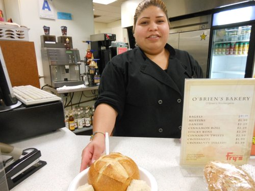 Denise delivers the soup in a bread bowl