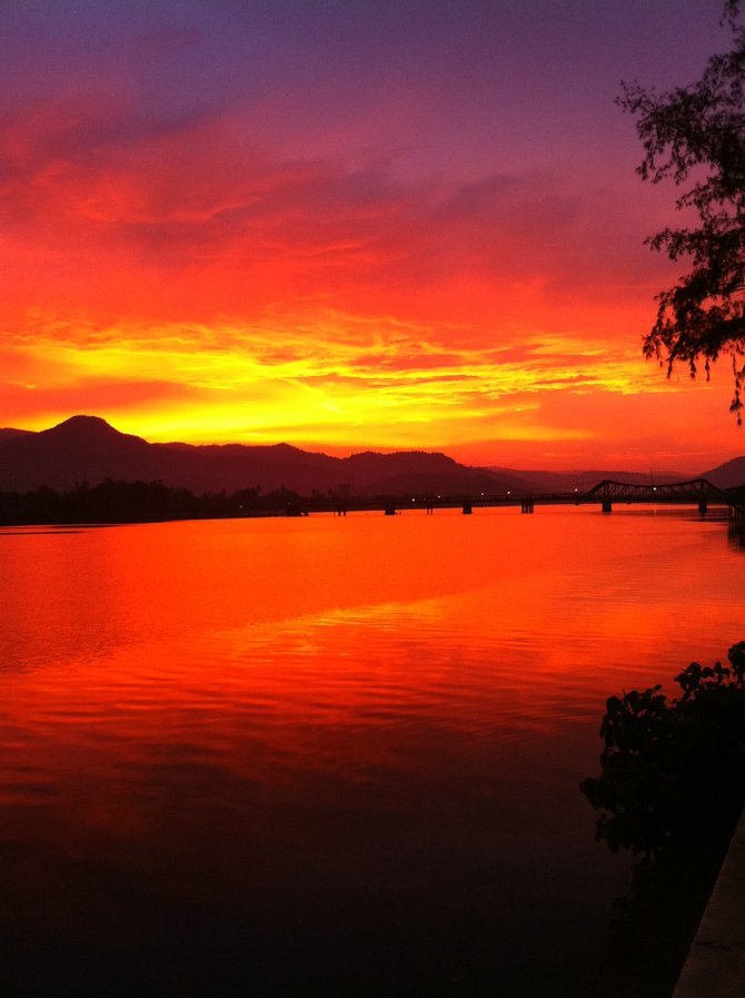 This photo was taken in July 2011 in Kampot. The locals said they had never seen a sunset like this...neither had I.