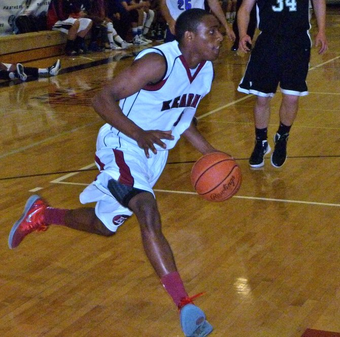 Kearny guard Janvier Alaby drives baseline