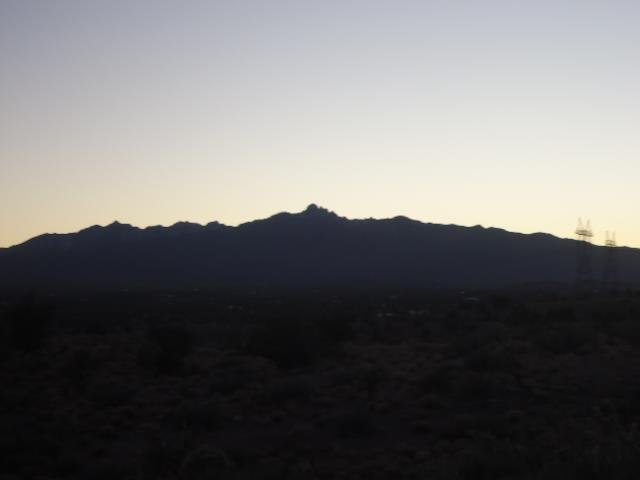 "Dusk in Kingman, Arizona. The sun went behind the ""mountain"" and the temperature went from 85 degrees Fahrenheit or so to about 50 degrees Fahrenheit in less than a half hour."