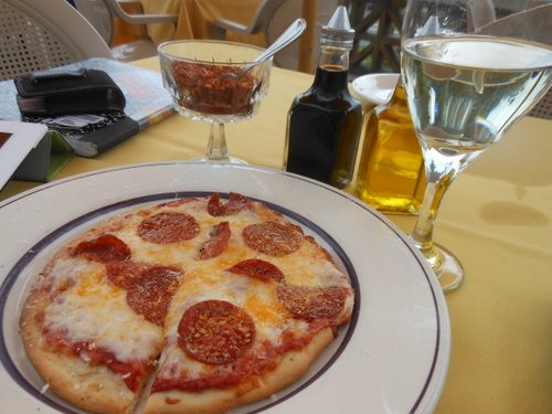 Dry peppers, balsamic vinaigrette, olive oil, and a glass of chablis all help add zest to the pizza