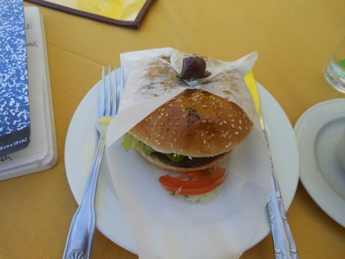 Burger comes with a bonnet, and a kalamata olive