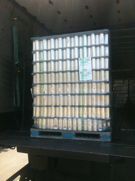 Naked empty cans sit ready for filling and labeling at Monkey Paw's East Village brewery.