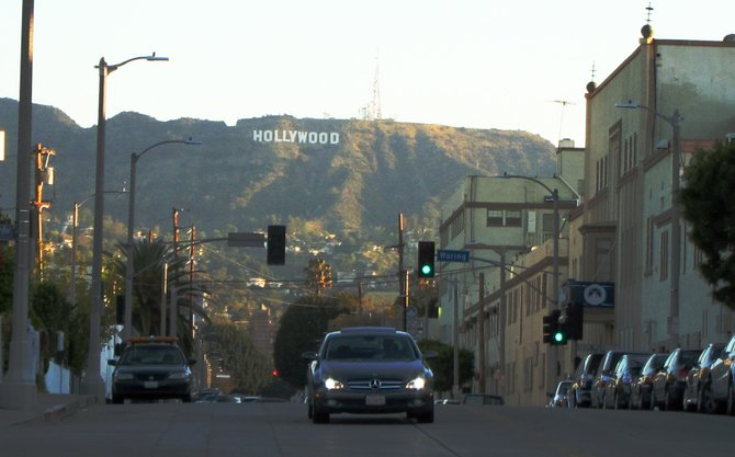 The Hollywood sign (and a car interrupting this photographer) in Hollywood.