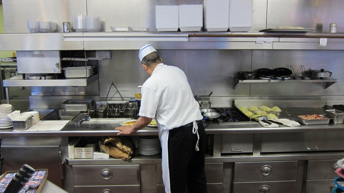 The cook at Astro Burger in Hollywood, making our breakfast.
