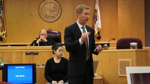 Prosecutor demonstrates making pipe bomb. Photo by Eva Knott.