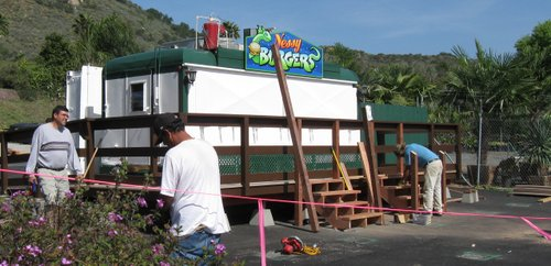 Jose Loera, far left, works to open Nessy Burgers Sunday.  PHOTO BOB WEATHERSTON