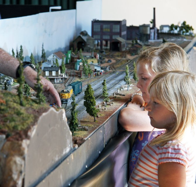 Two girls learn about model trains at Templars Hall in Old Poway Park
