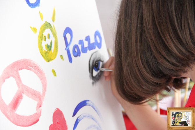 A small child painting a beautiful eye.