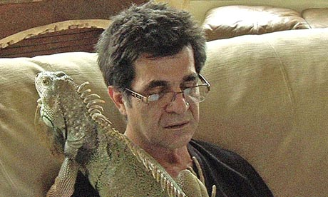 The director as scratching post: Jafar Panahi and his daughter's pet iguana.