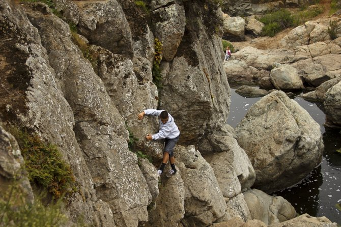 Climbing the rocks at the waterfall in Los Peñasquitos Canyon Reserve.  (Sorrento Valley)