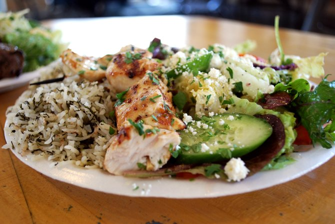 Chicken combo plate with herb rice and mixed salad