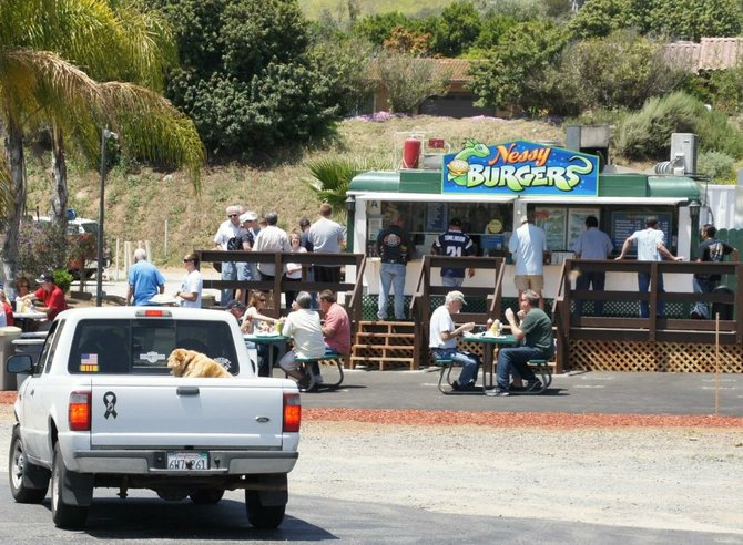North County residents enjoy a meal at Nessy Burgers.  Photo Bob Weatherston.