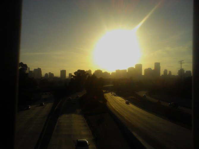 A picture taken of Downtown San Diego, from a view atop the Martin Luther King Freeway.