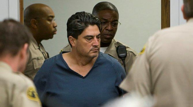 Robles brought into Vista courthouse Nov 30 2011.  PHOTO NICK MORRIS.