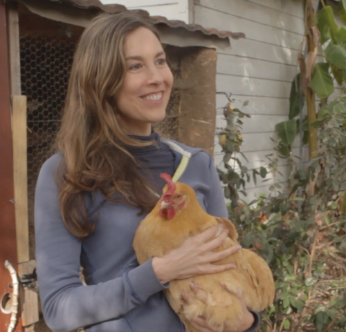 Rebecca Tolin holds a chicken for the first time.