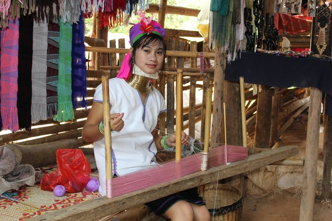 Long neck tribe in Chang Rai Thailand making wraps