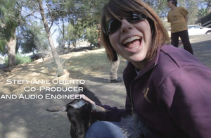 Stephanie quickly befriends baby goat.