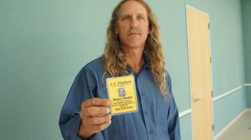 James Playford with his media credential.  Photo Bob Weatherston.