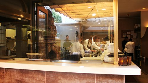 Chef voyeurs will enjoy getting a seat on the patio, which offers a view of a busy kitchen full of white coats.