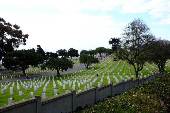 Point Loma.  Flags grace the headstones at Ft. Rosecrans National Cemetery in preparation for the Memorial Day holiday.  Boy Scouts, Girl Scouts and volunteers placed flags on more than 67,000 headstones Saturday from 7:45 to 9:30.