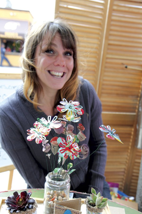 Aluminum cans live a second  life as colorful flowers.