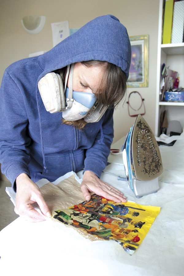 Salvaged Goods owner Shelby Hartman works on a fused-plastic wallet.