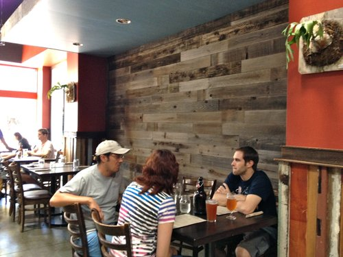 Beautiful warm reclaimed wood lines the walls, expansive windows let in  plenty of natural light and offer views of the passing street scene. - A Bite Of Hillcrest At Local Habit San Diego Reader