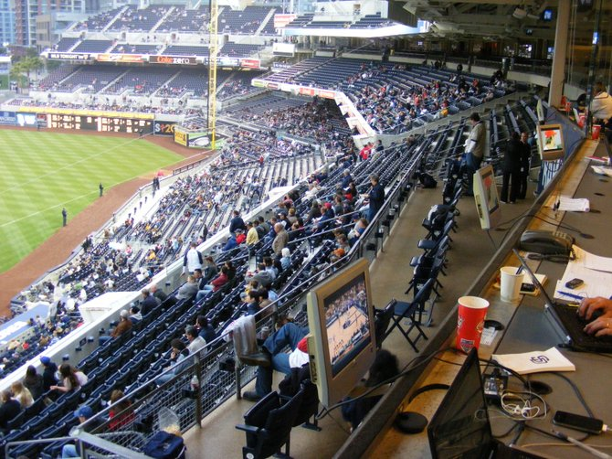 View of the sparse crowd in the stands in right field from the press box.