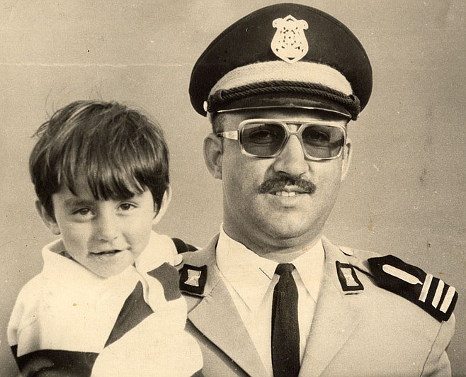 """Zia Waleh holds his son Walid, circa 1974.  Back then he was a police chief who, Khaled says, """"hunted down the communist secret organizations."""""""