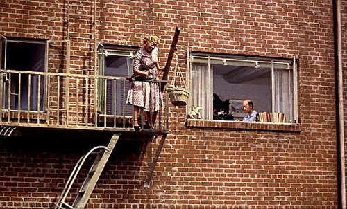 "Sara Berner, the dog that knew too much, and Frank Cady in Alfred Hitchcock's ""Rear Window"" (1954)."