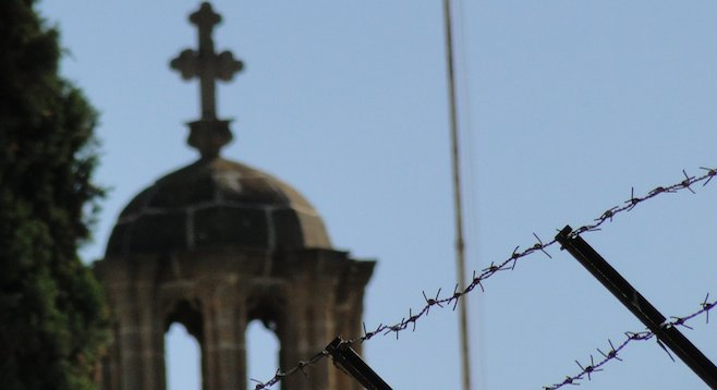 Evidence of a culture gap: barbed-wire barricade near Greek Orthodox church, Nicosia.
