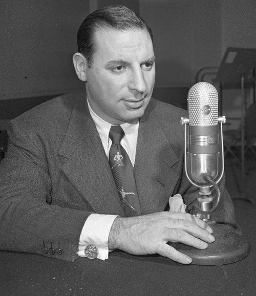 Nattily-tied Chicago Sun-Time Columnist, Irv Kupcinet, tongue-tied as usual.