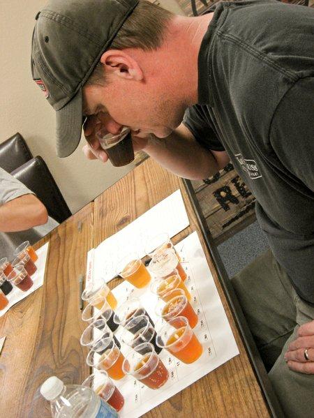 Karl Strauss head brewer Matt Johnson judges the merits of a field of fresh homebrew competition entries.