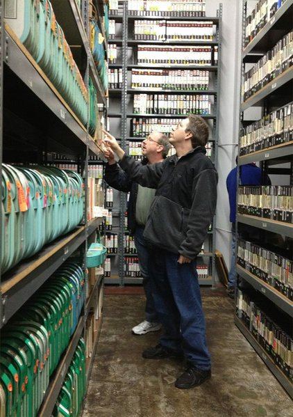 Reelin' President David Peck (right) and Vice President Phil Galloway (left) examine the storage facility holding over 20 years of tapes from the Merv Griffin Show, RITY's newest archive partner.