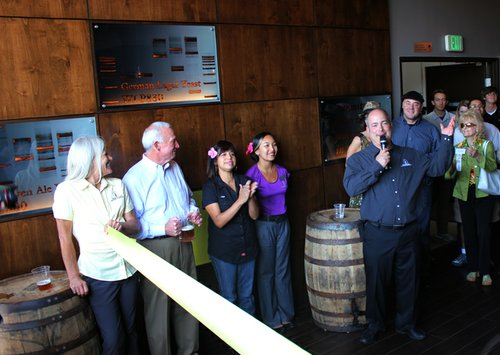 White Labs owner Chris White addresses the crowd at the grand opening of the company's tasting room on June 15