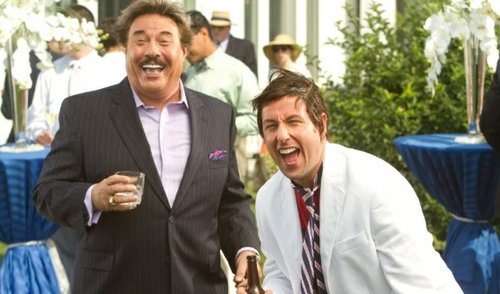 Adam Sandler acts as a yellow anchor tied around Tony Orlando's neck.