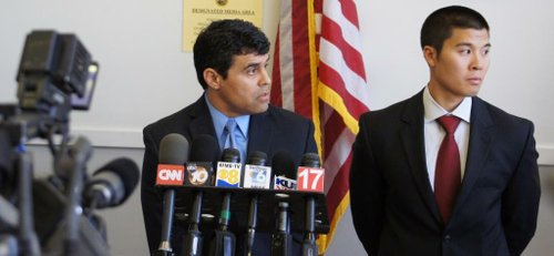 Prosecutors Pat Espinoza and Garret wong face off against the media.  Photo Bob Weatherston.