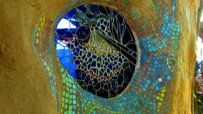 Stained glass window and mosaic outside Hubbell's hut