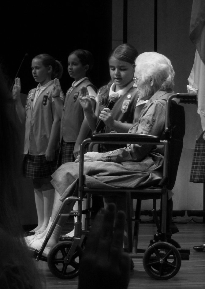The oldest girl scout (age 96) and the youngest girlscout (age 5) in San Diego, onstage together reciting the Girl Scout Promise for the Gold Award Ceremony