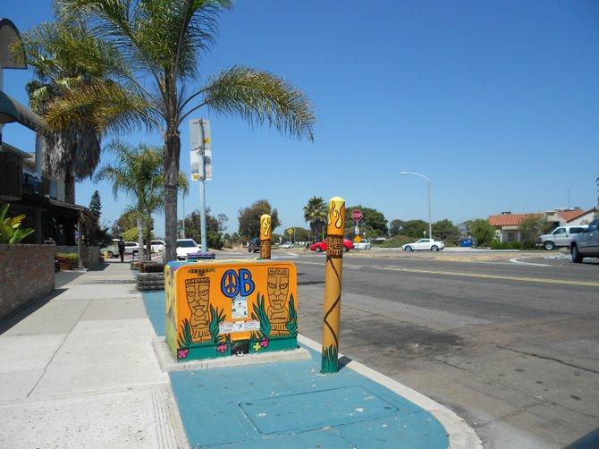 Tiki peace-themed utility box art in Ocean Beach.