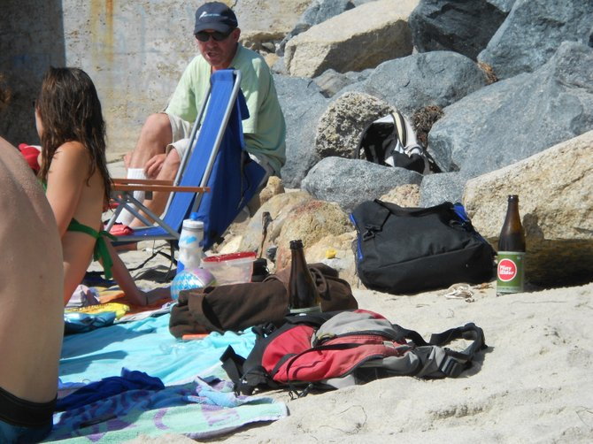 Glass bottles are no-no's along the sand but these tourists had no clue in Ocean Beach.