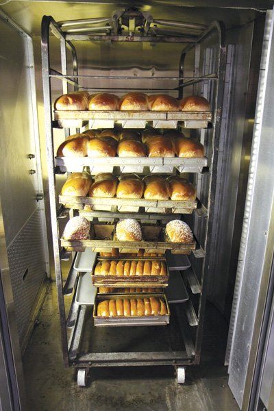 Soft loaf breads are baked in these large computerized convection ovens. Each style of bread has a program to control heat, steam, and venting.