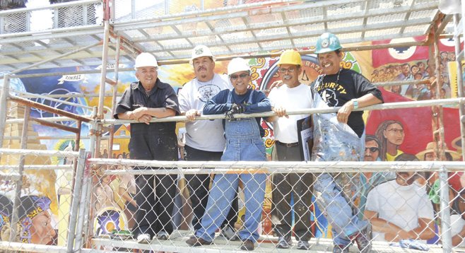Chicano Park muralists regroup to refresh their 40-year-old works. - Image by Bill Manson