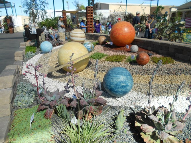 The planetary system encased in gravel at the Del Mar Fair.