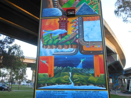 "Michael Schnorr's mural on a pillar: ""The Undocumented Worker."""