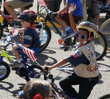 Boy scouts on bicycles.