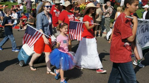 Families dressed  in red, white, and blue.  Photo Bob Weatherston.