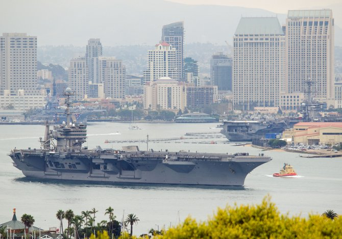 The aircraft carrier Stennis leaves San Diego bay on July 5, with carriers Carl Vinson and Midway in the background.
